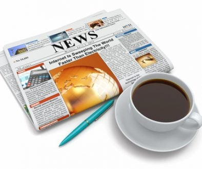 Coffee cup with newspaper